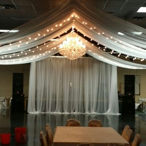 DesignLight chandelier and overhead voile fabric