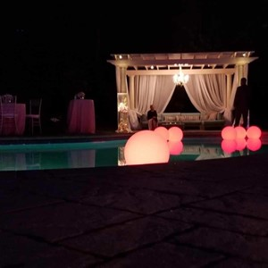 DesignLight backyard wedding lighting on pool
